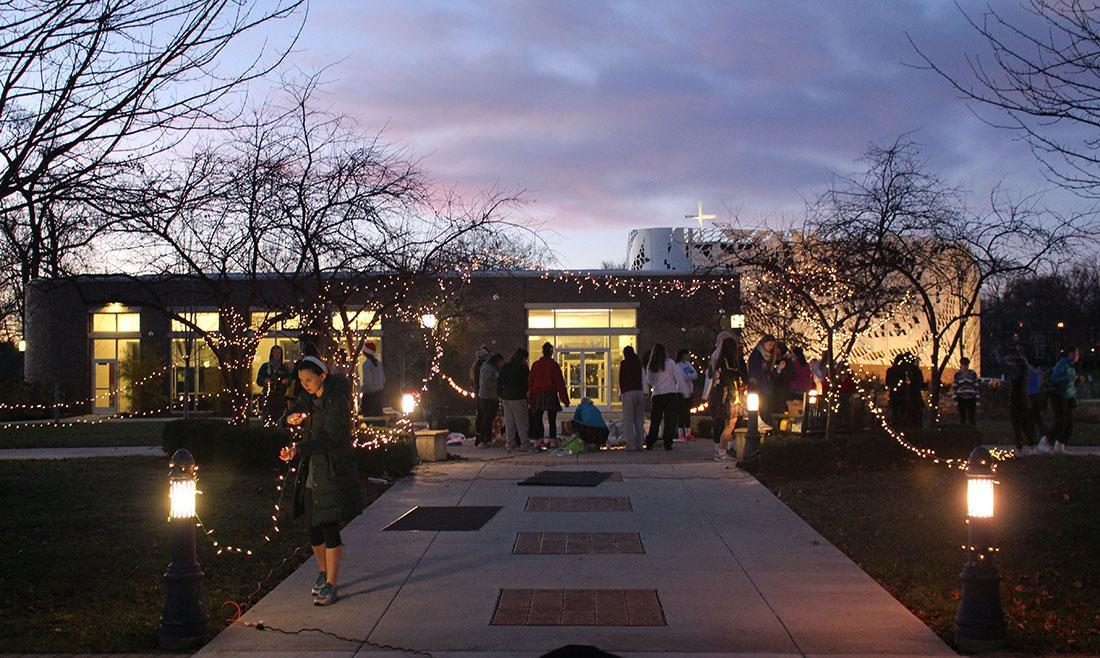 Students from the senior class gathered before school Wednesday Dec. 9 to decorate the quad in remembrance of STA alumna Becca Lueke who passed away two years ago. Students decorated the quad with Christmas lights and left flowers on the seal. photo by Kat Mediavilla