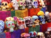 Painted skulls display bright colors on an alter installation in Kirkwood Hall at the Nelson Atkins Museum Nov 7. The skulls are displayed to honor the souls of the dead. Photo by Meggie Mayer