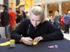 STA senior Regan Reda writes names of the deceased on a paper flower at the Dia de Los Muerto celebration Nov 6. Guests were welcomed to write names of those close to them who have died and place it on an alter to honor their souls. Photo by Meggie Mayer
