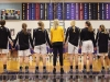 The STA varsity basketball team holds hands during the singing of the National Anthem before their game. The Stars competed agains Belton High School Friday for the District title. photo by Kat Mediavilla