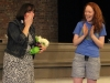 English teacher Katie Dolan tears up May 19 in the M&A auditorium as junior Grace Girardeau presents her with the class ring students purchased for her as a gift for her last year at STA. photo by Maggie Knox