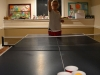 A photo illustration of a student playing beer pong. photo by Hannah Bredar