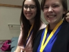 Seniors Casey Campo, left, and Erin Burroughs smile for a photo after receiving their medals. Campo and Burroughs competed in the Business Financial Plan event and received second place for their gym business,