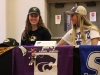 Seniors Grace Kitts, left, and Maddy Russell smile before they sign their National Letters of Intent to play collegiate soccer next year. Kitts will attend the University of Missouri and Russell will attend Kansas State University. photo by Maggie Knox