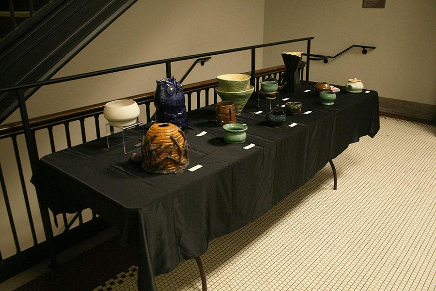 STA students display pottery from various classes at the Fine Arts Showcase April 27. photo by Cassie Hayes