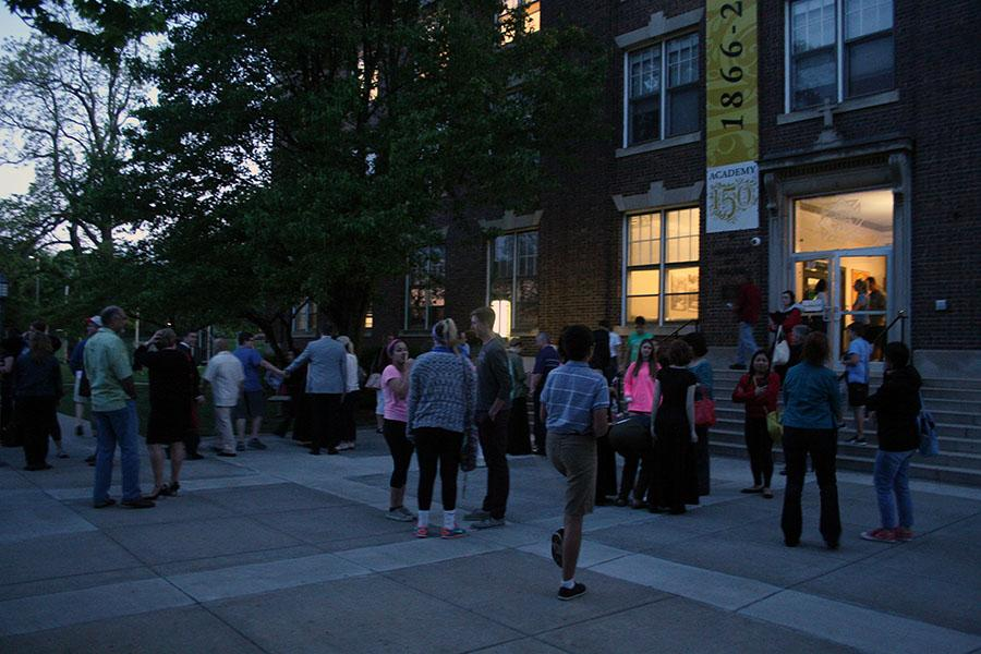 Students, family members, and teachers showly filter out of the M&A building after the choir's performance at the Fine Arts Showcase April 27. photo by Cassie Hayes