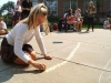 Junior Grace Reda sketches some chalk stars outside of the Donnelly building Sep.4. photo by Violet Cowdin
