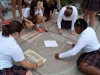 The Fisher advisory works on their chalk contest drawing for this years frosh fest. photo by Violet Cowdin