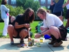 Seniors Isabella Matthews, left, and Maureen Whittaker carefully select the chalk that they will use for the Frosh Fest chalk art competetion. The two seniors helped create a Wizard of Oz themed chalk design for the Gargallo advisory. photo by Kat Mediavilla
