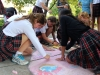 Members of the Walker adivosry work together to complete their sidewalk chalk design for STA's annual Frosh Fest. The Walker advisory based their chalk drawing on a Mario theme. photo by Kat Mediavilla