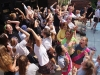 Students gather to sing and dance towards the end of the annual Frosh Fest chalk competetion. Students ate lunch, danced and bonded with their advisories during both activity periods Wednesday Aug. 26. photo by Kat Mediavilla