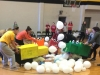 Students participating in the hungry hungry hippos game charge towards the middle trying to collect as many balloons as they can Feb. 4. photo by Paige Powell