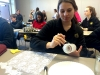 Sophomore Katelyne Kratofil paints her jar with glue before applying the lace. photo by Paige Powell