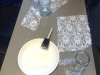 Supplies to make lace candle holders sit on a table in Windmoor during Catholic Schools Week. The project included a video of where CSJ lace-making began and star cookies. photo by Paige Powell