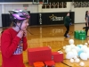Freshman Victoria Parsons straps her helmet on before participating in the hungry hungry hippos game Feb. 4. photo by Paige Powell