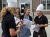 Junior Maeve Madden, from right, seniors Anna Moore and Rose Madden talks about plans to encourage students to join Cooking Club at the club fair Aug. 23. photo by Paige Powell