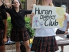 Members of Human Dignity Club hold up a sign at the club fair. photo by Paige Powell
