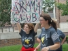 Sophomore Reilly Donnelly holds up a Drama Club sign while Junior Courtney Talken tries to get people to join the club.