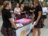 Senior Allison Nagle talks to students about joining Students for Life at the club fair Aug. 23. Students for Life is a pro-life organization educating people on topics such as abortion, euthanasia and the death penalty. photo by Paige Powell