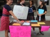 Moderator Kim Sirridge, from left, senior Isabel Burnet, Juniors Julia Mantel and Edie Livers laugh together while encouraging people to join Care Club at the club fair Aug. 23. photo by Paige Powell