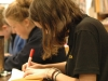 Participants in Art Club draw on their pieces of paper during clubs on Thurs. Sept 22. photo courtesy of Lulu Fiss