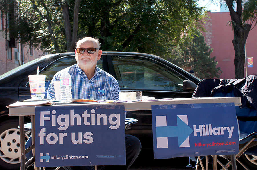 A volunteer campaigns for Hillary Clinton  at the River Market in Downtown Kansas City, Missouri Sep. 17. photo by Meghan Baker