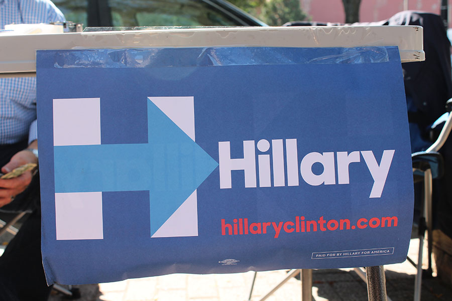 A Hillary Clinton campaign poster hangs from a table at the River Market in Downtown Kansas City, Missouri Sep. 17. photo by Meghan Baker