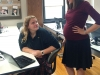 Kayla Leatherman helps senior Annie Alderman with her online personal finance class. Leatherman is six months pregnant.