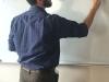 STA theology teacher Michael Sanem teaches writes the word