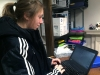 Senior Rachel Allard types her printer ID and password into her netbook. Each student is given their own ID and password. photo by Paige Powell