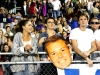 Juniors Maura Knopke and Jeanne O'Flaherty hold up Rockurst senior Iver Vinsaint's face in the student section Oct. 9.