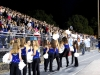 Members of the dance team wave to their friends in the student section before they take the field for their performance.