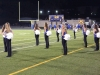 The dance team takes their position on the field before they perform at the Rockhurst High School football game halftime Oct. 9.