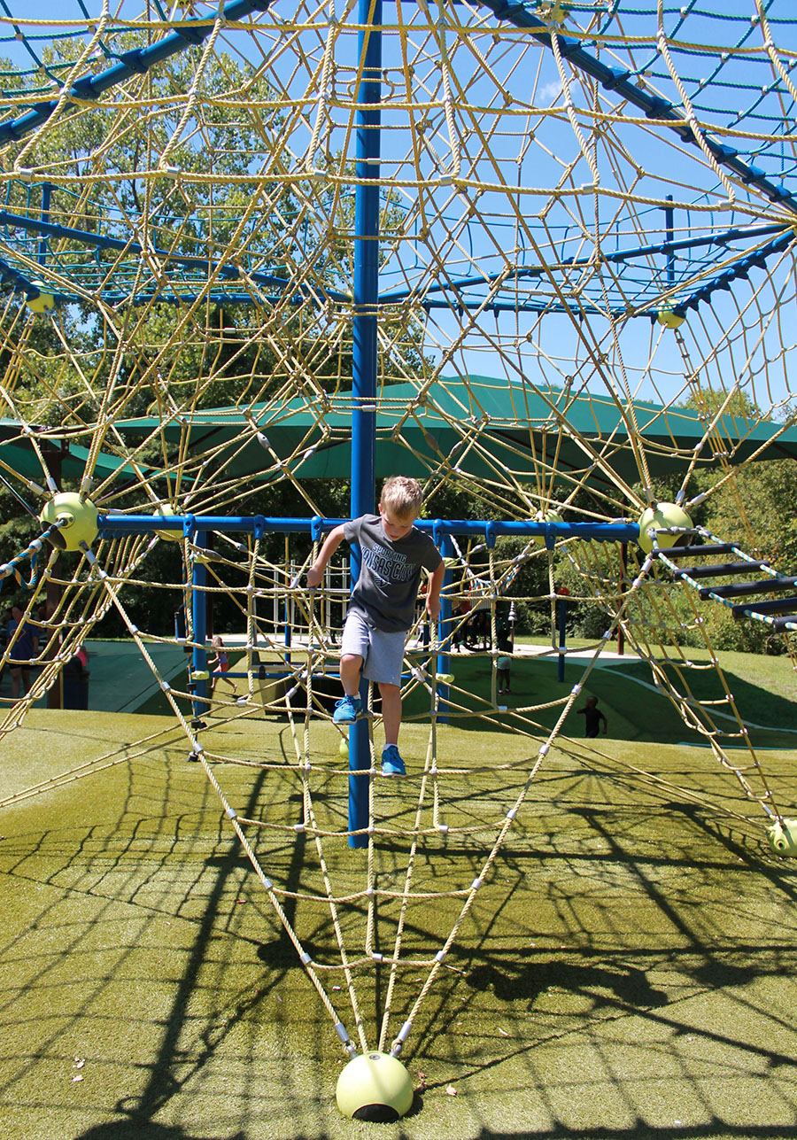 Max Baker, a first grader from St. Elizabeth Catholic School,  climbs down a rope structure at Valley Park in Grandview, Missouri Aug. 21. photo by Meghan Baker
