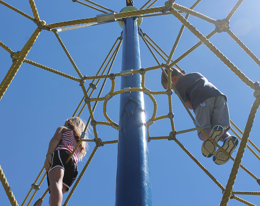 Molly Roudebush and Max Baker, both first graders, climb at Valley Park in Grandview, Missouri Aug. 21. photo by Meghan Baker