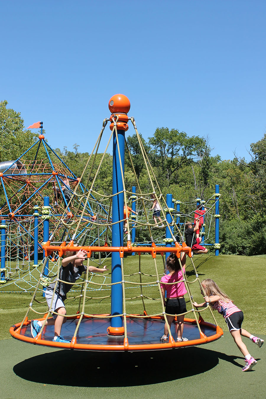 Three children play at Valley Park in Grandview, Missouri Aug. 21. photo by Meghan Baker