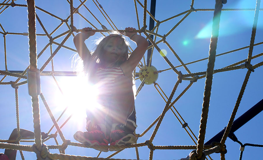 Molly Roudebush, a first grader, climbs the ropes at Valley Park in Grandview, Missouri Aug. 21. photo by Meghan Baker