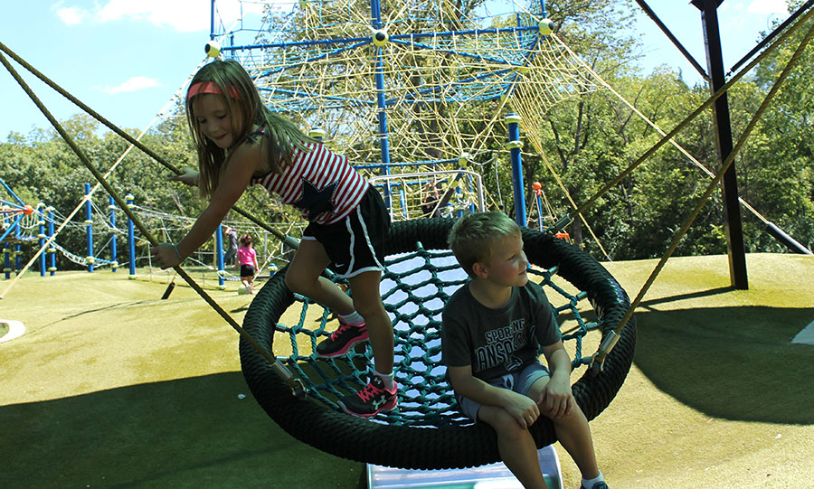 Molly Roudebush and Max Baker, both first graders, swing together at Valley Park in Grandview, Missouri Aug. 21. photo by Meghan Baker