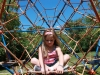 Molly Roudebush, 6 years old, waits to climb at Valley Park in Grandview, Missouri Aug. 21. photo by Meghan Baker