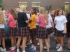 Seniors gather in the parking lot before school for the first tailgate of the school year. The senior tailgate is a tradition at St. Teresa's Academy. photo by Paige Powell
