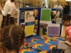 A poster from the Rainbow Center is put on display at the service fair held in the commons on Friday, September 30th. The Rainbow Center is an agency whiich works with special needs people all the way from the ages of three to twenty-one. photo by Riley McNett