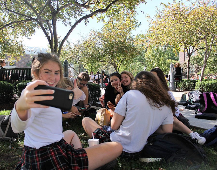 Junior Lauren Lynch takes a selfie with her friends during a fall yard day on Oct. 17. Photo by Meghan Baker