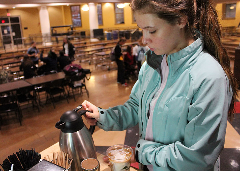 Freshman Sophie Slocomb makes coffee at Starcups at St. Teresa\'s Academy on Nov. 13. Starcups serves breakfast food, coffee and tea every friday morning. photo by Meghan Baker