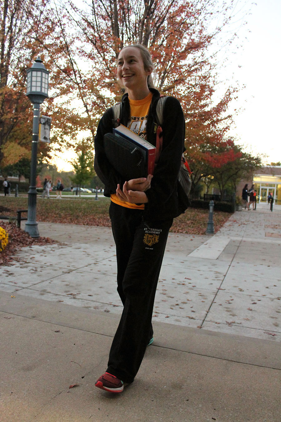 Junior Emma Anielak wears STA auction sweatpants with an STA t-shirt at St. Teresa\'s Academy on Nov. 4. Students are allowed to wear a non-uniform STA shirt or sweatshirt every friday. photo by Meghan Baker