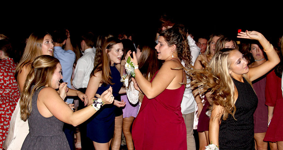 Seniors Hannah Zastrow, Lindsey O'Leary, Maria Tilson, Mary Claire Connor, and Sophie Sakoulas dance at their last Teresian in the Goppert Center on Oct. 15. Photo by Anna Kate Powell