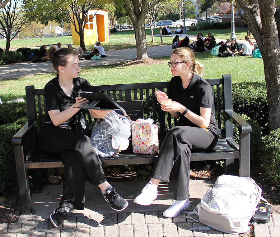 Sophomores Hannah Bechtel and Hannah Jirousek do homework on a bench in the quad at St. Teresa's Academy on Oct. 17. Photo by Meghan Baker.