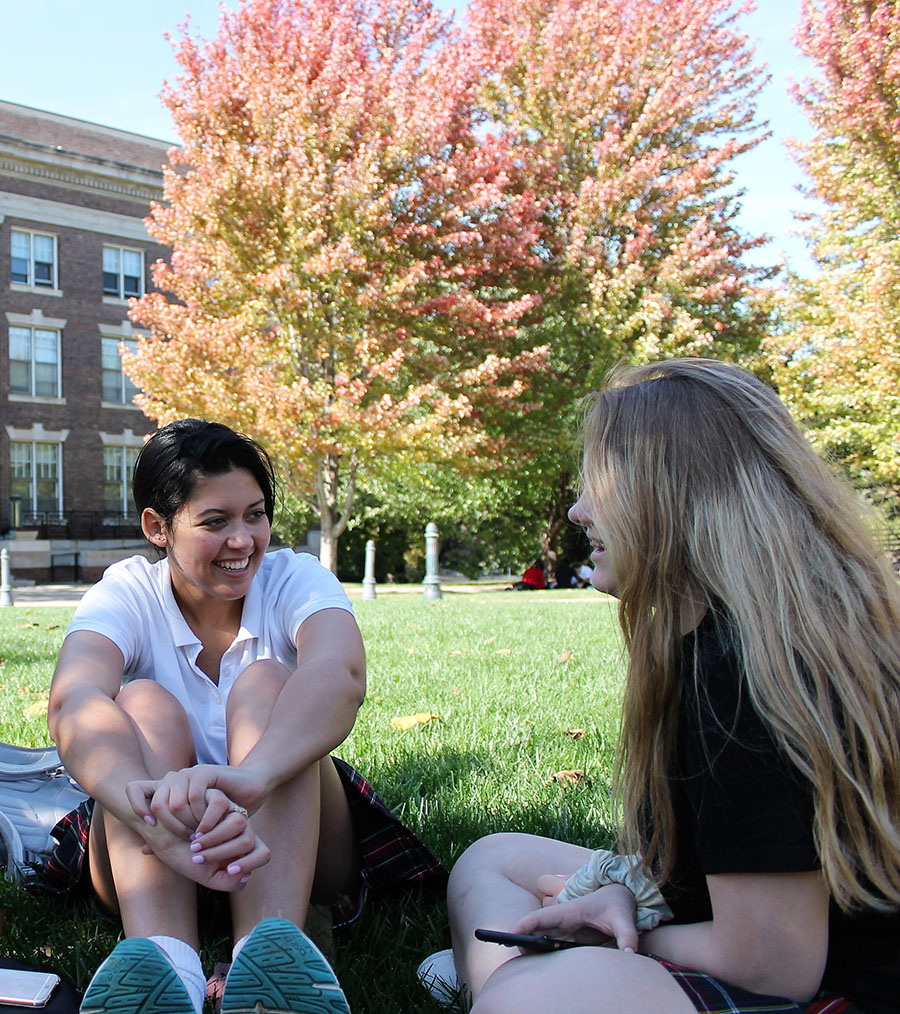 Seniors Haylee Gant and Caleigh Wilson talk in the quad at St. Teresa's Academy on Oct. 17. Photo by Meghan Baker.
