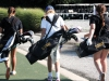 Sophomore Gabi Dorrell, from left, junior Jessie Culver and junior Suzie Fiss carry their bags into the club house after practice Sept. 10 at Heart of America Golf Course. The team is working on their short game this year which includes putting and chipping.