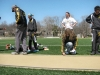 """Track coaches and players prepare for the long jump at the track invitational held at STA April 4. """"€œWe were very fortunate to have the best track in the city and the first and only good day of weather this spring,"""" jump coach Matthew Voelker said. by Viridiana Hernandez"""