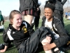 """Freshman Machella Dunlea, left, endures the pain while Ryan Wilkins attempts to massage out her cramp during the track invitational April 5. """"Stuff like this happens all the time in track,"""" sophomore Haley Baldwin said. """" We're a team, so we help each other out."""" by Viridiana Hernandez"""